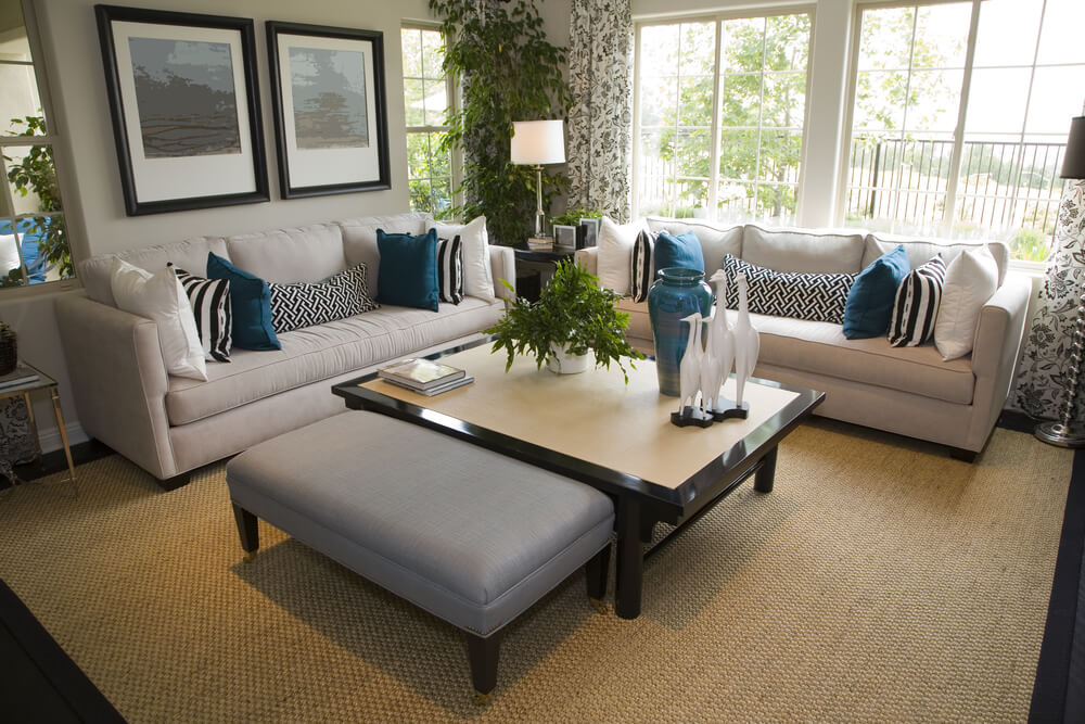 Cottage Style Living Room With Off White Sofas Decorated With White And  Blue Pillows.