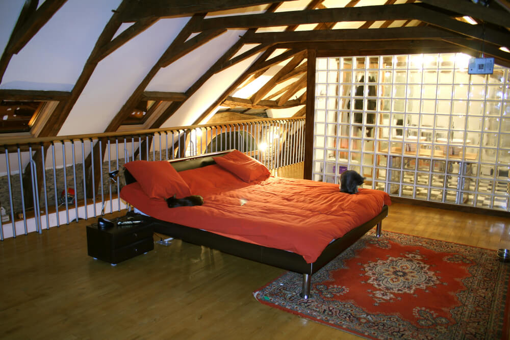Bedroom and bathroom in loft space.