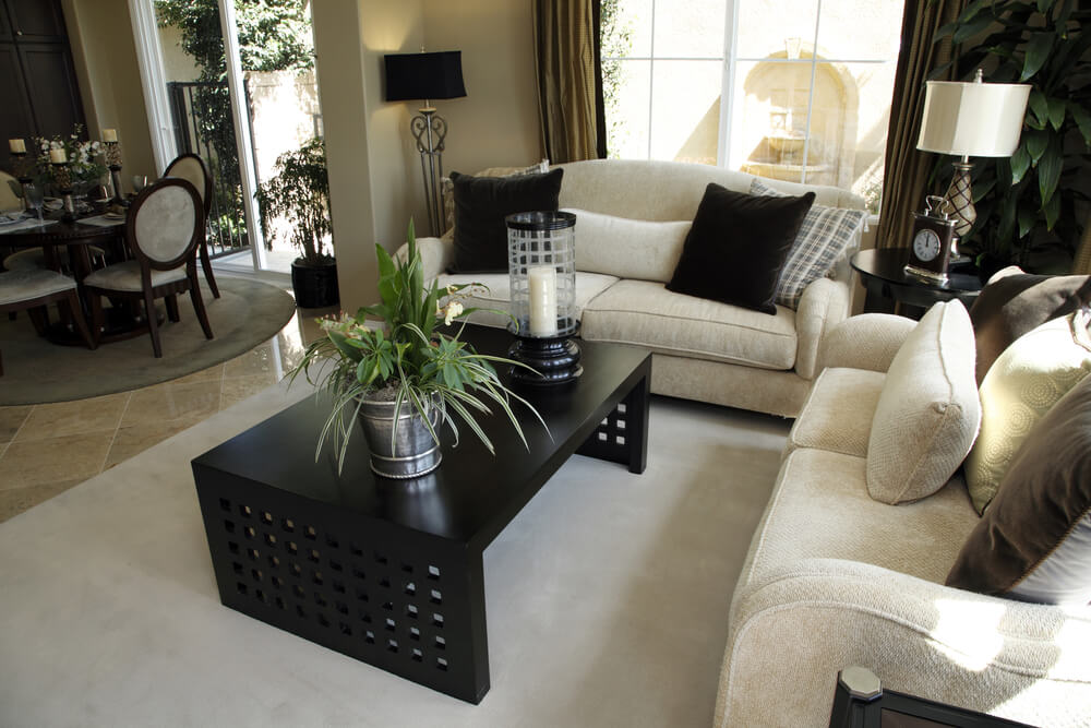 Light And Dark Living Room Design With Offwhite Sofas And Dark Coffee Table  On