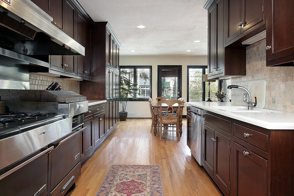 Narrow Cooking Area Opens Into Wide Dining Room In This Kitchen Featuring  The Familiar Match Of