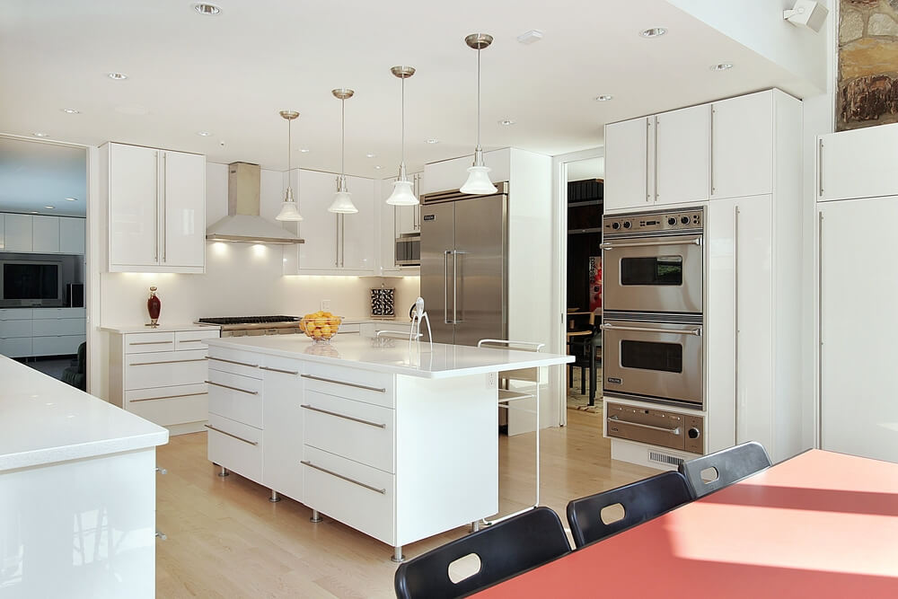 Modern, Minimalist Design Here Features Slick White Surfaces On Every  Cupboard And Wall, All