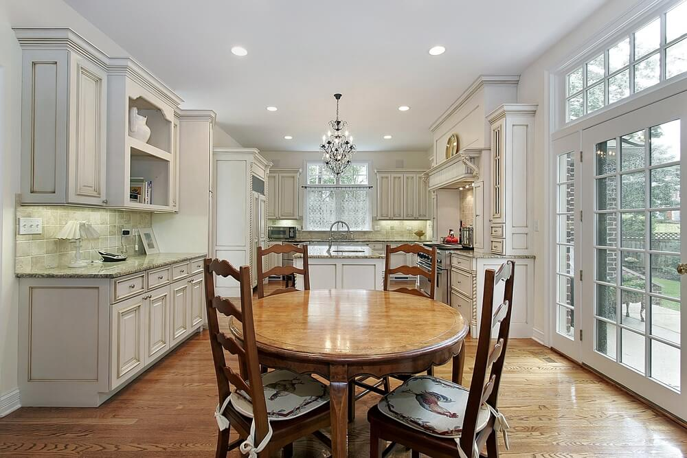 Here We Have A Kitchen Featuring Painted Details On White Cupboards Large Glass Door To
