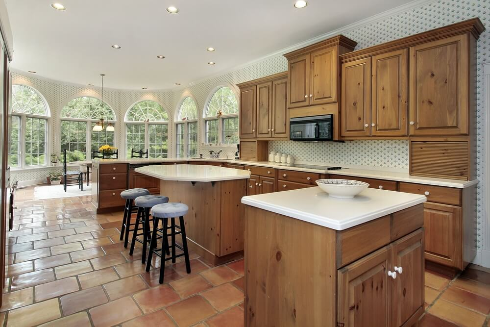 Traditional tile flooring in this expansive kitchen reaches all the way into rounded dining area.