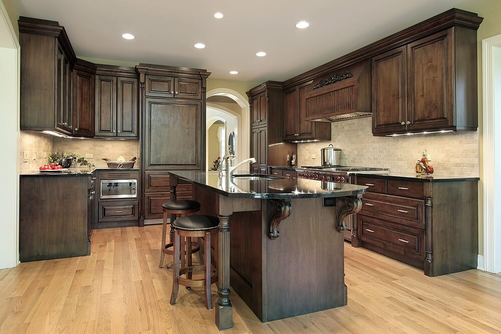 Truly Dark Wooden Cabinets And Island, Along With Black Countertops, Work  With The Light