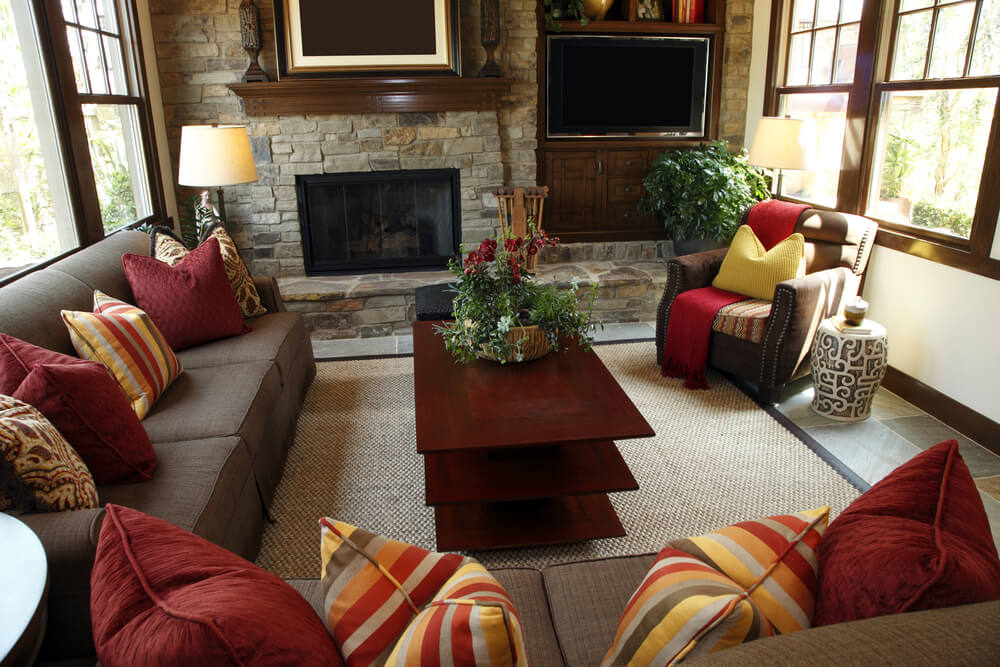 Rustic Living Room Design With Brick Wall Containing A Fireplace And Television Brown Sofas Are