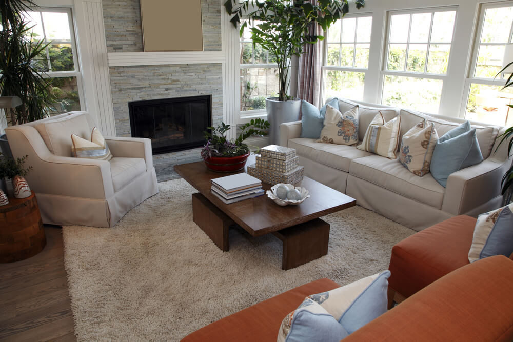 Living Room Space With Two Reddish Brown Chairs, One Beige Sofa And One  Beige Armchair