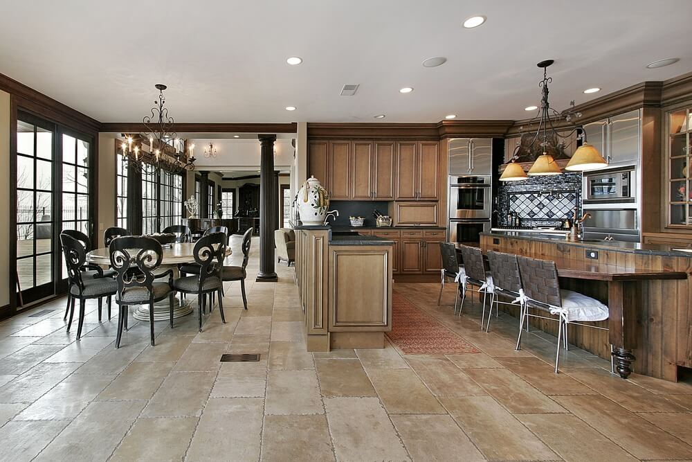 ornate textures abound in this kitchen featuring stone tile flooring naturally dark wood cabinets and flooring a17 wood