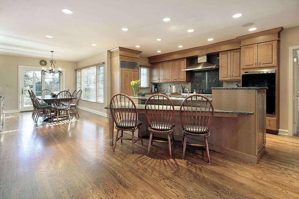 This is an example of a more traditional looking kitchen using lighter wood colors and an open floor plan.