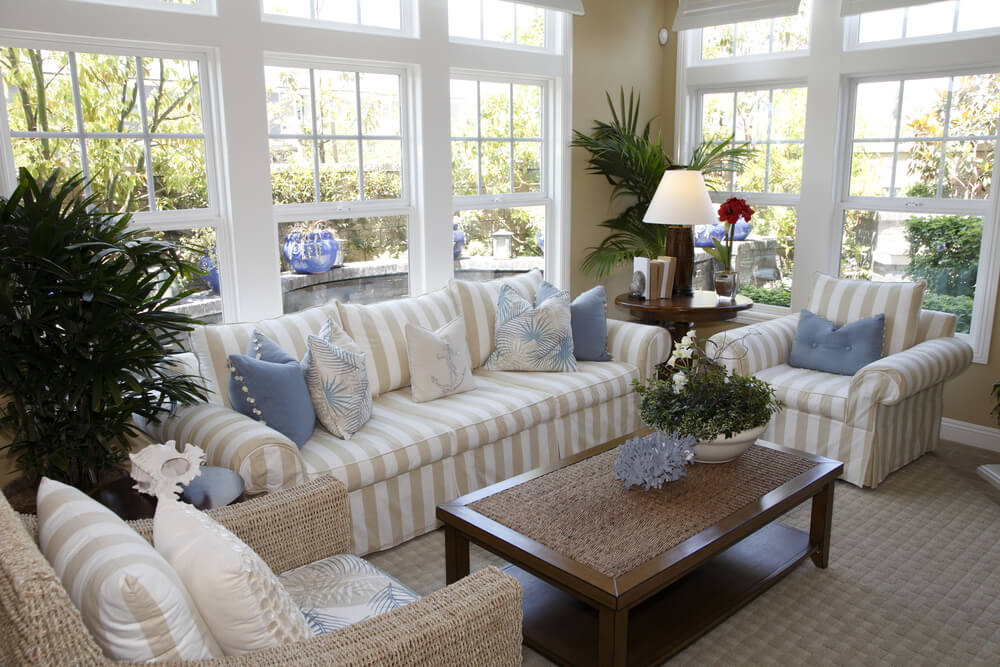 Cottage Style Solarium Living Room With Beige And White Striped Furniture,  One Armchair Being A