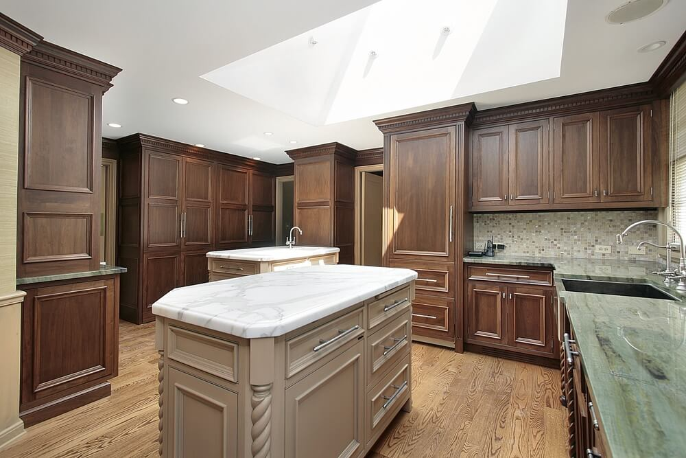 Unique Color Combination In This Kitchen Features Subtle Dark Colored Wood  Cabinets Floor To Ceiling,