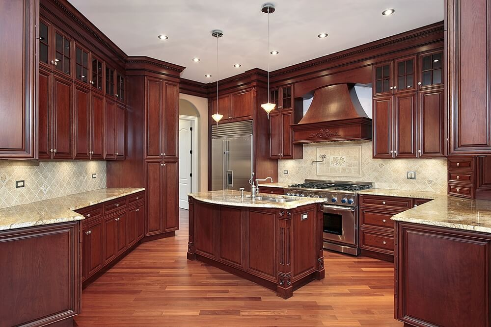 here we have another great example of cherry wood contrasting with a more natural tone on - Cherry Kitchen Cabinets