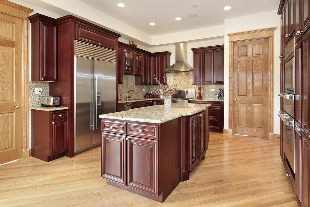 Angled View Of Kitchen Featuring A Combination Cherry Wood Cabinetry And Natural Flooring
