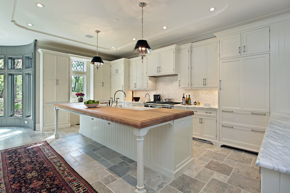 This Large White Kitchen Features Detailed Ceiling Figures, Round Breakfast  Nook Area, Stone Tile