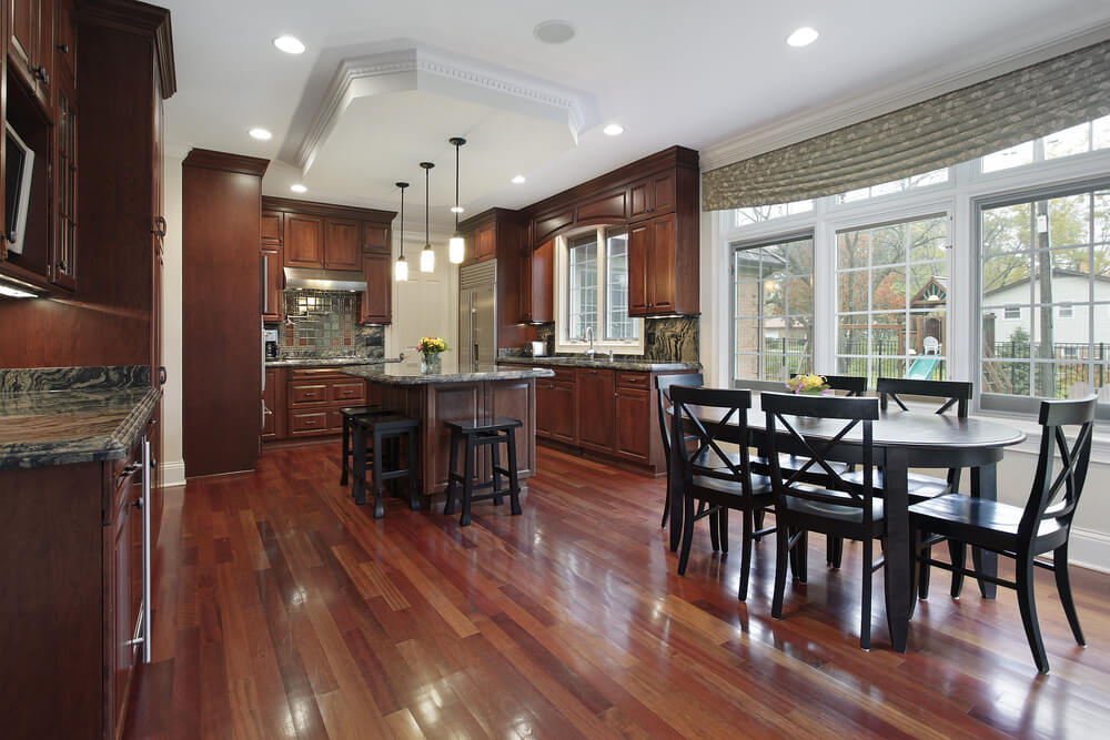 Red Hardwood Floors And Cabinets Tie This Kitchen Together.
