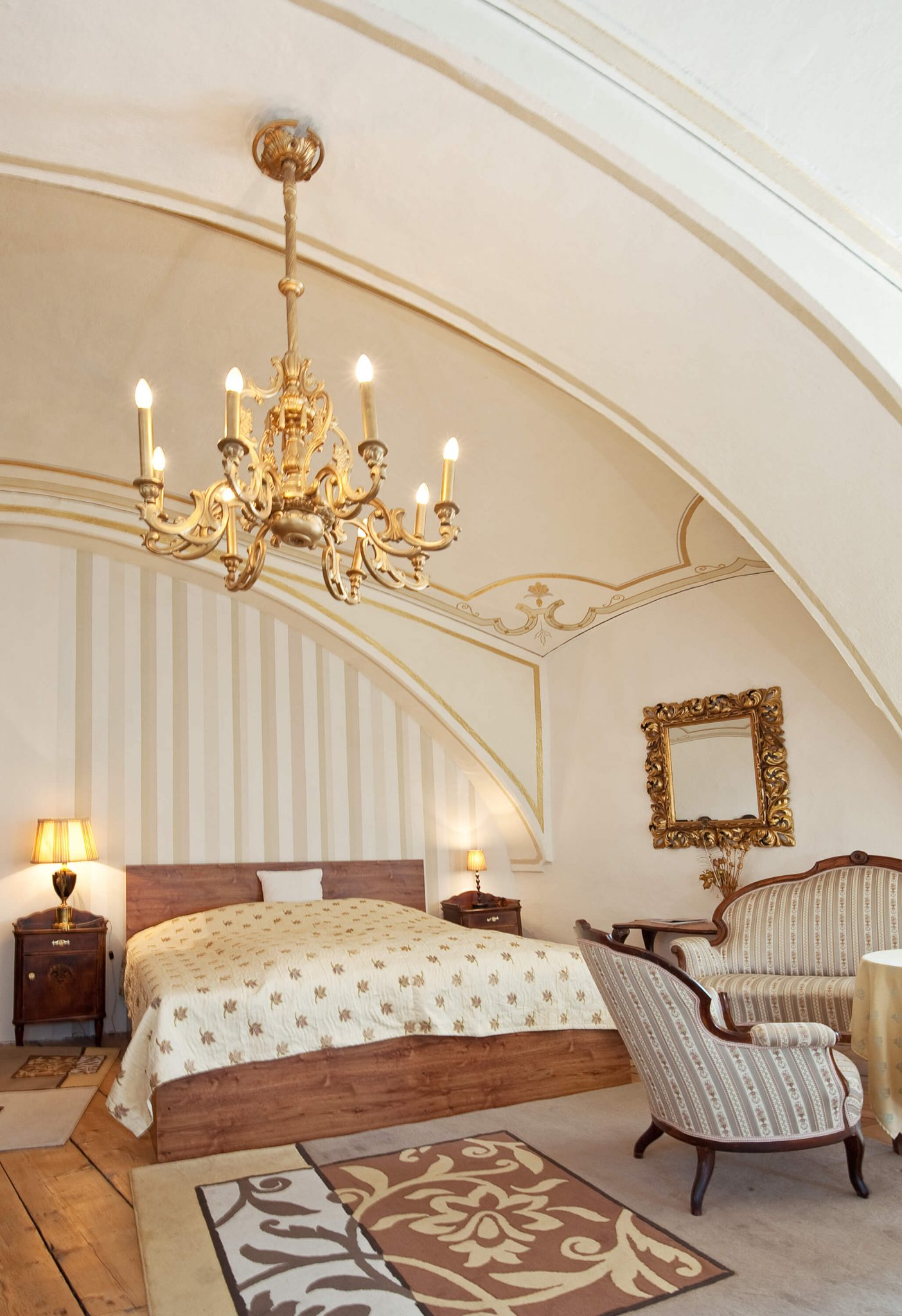 This room features a large arcing ceiling punctuated by gold chandelier.
