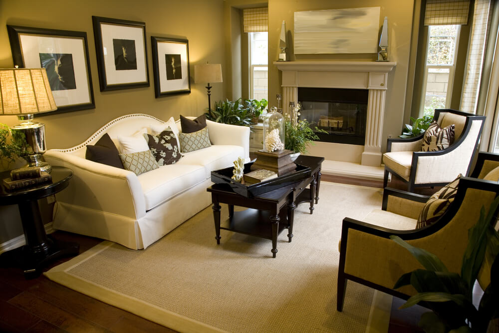 Greenish Brown Walls Wrap Around This Living Room With Fireplace White Sofa Two