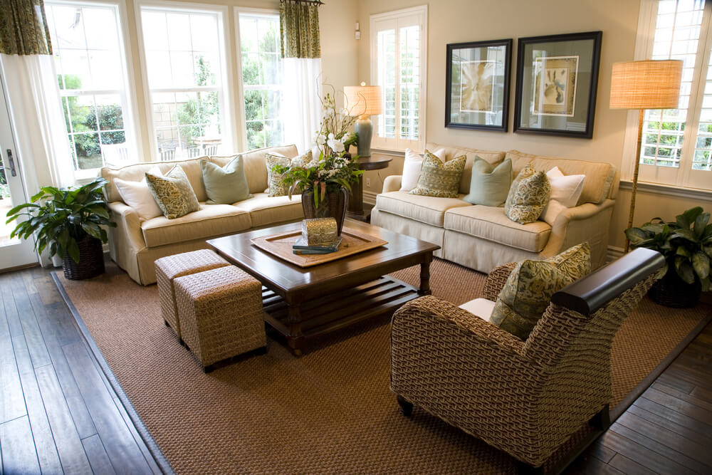 Contemporary Living Room Design With Two Matching Off White Sofas Loaded  With White And Soft