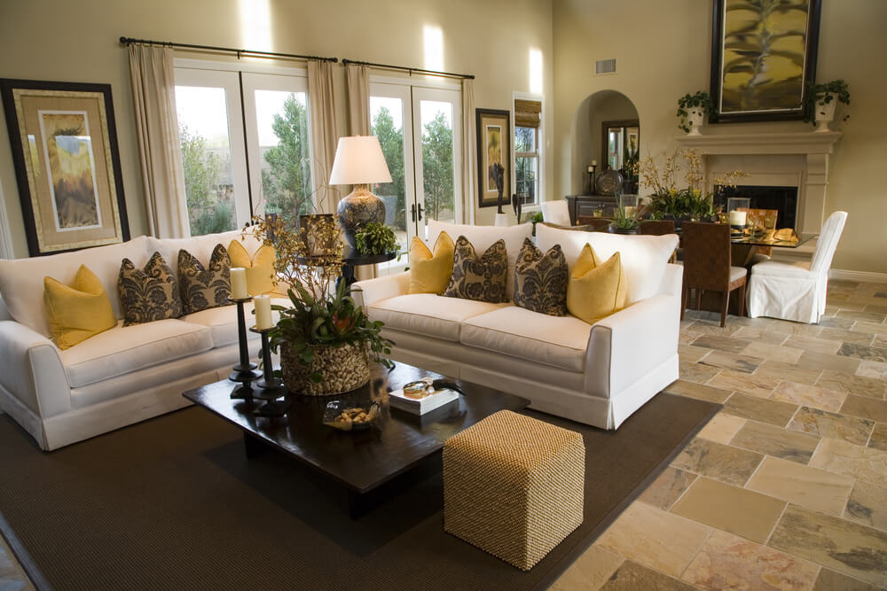 Large Open Concept Home With Dedicated Living Room Comprised Of Two White  Sofas Decorated With Yellow