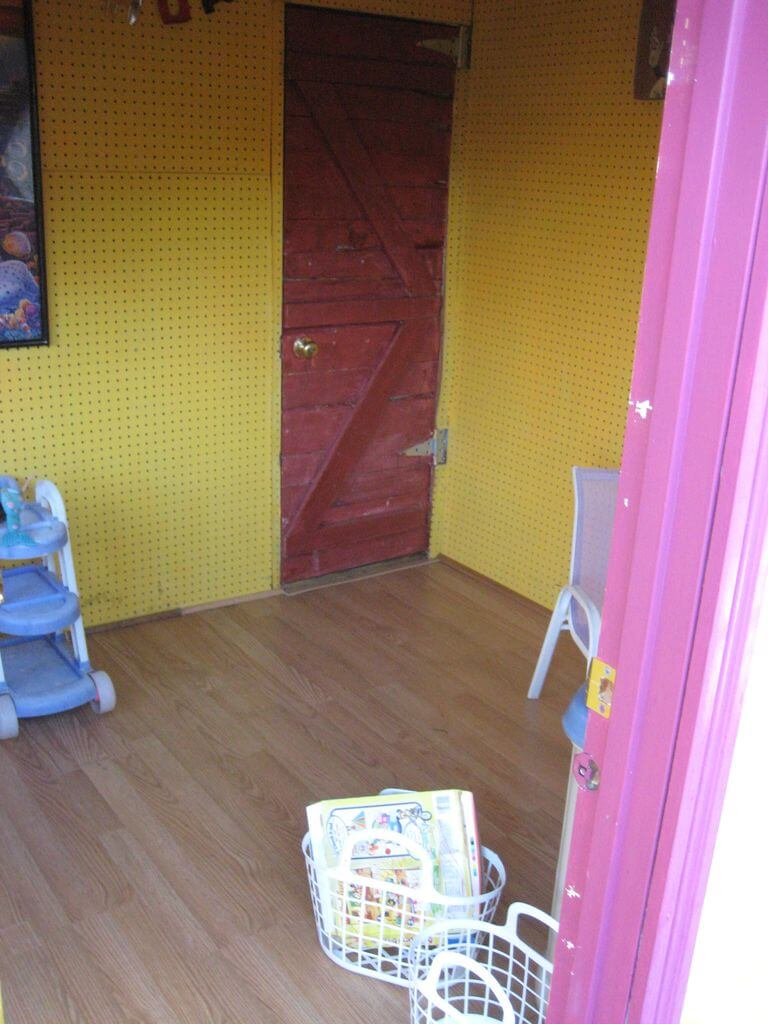 Interior of the yellow finished wooden pallet playhouse