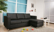 Black chaise lounge style sectional sofa