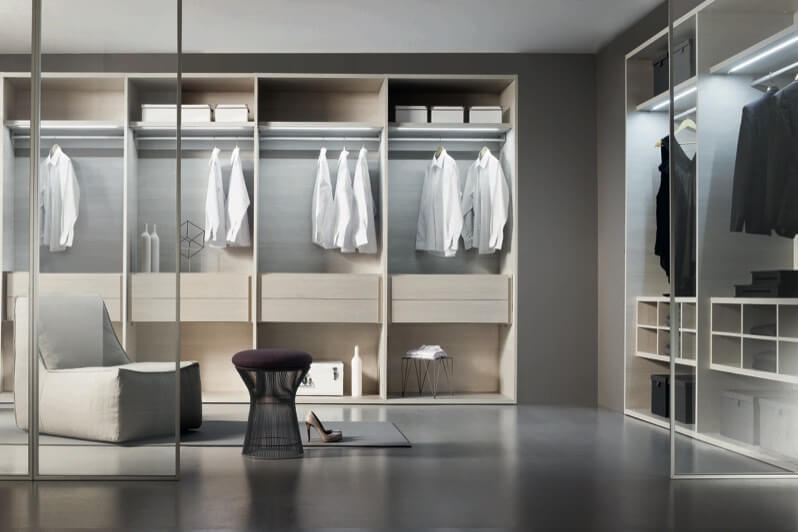 This Intricately Detailed Walk In Closet Space Is Divided By Floor To  Ceiling Glass Panels,
