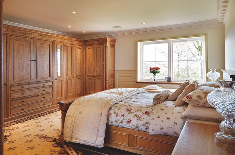 Master bedroom with extensive custom cabinetry.