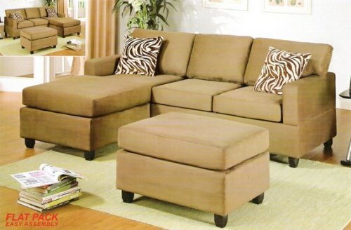 This three-piece microfiber sectional is reversible and comes with pillows and an ottoman.