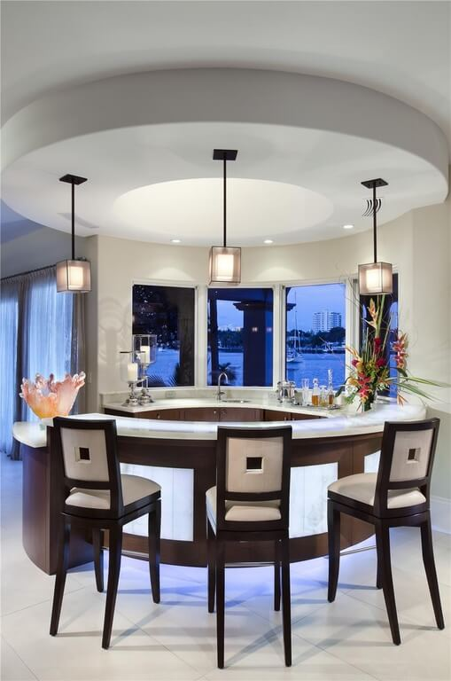 Circular accents on the ceiling offset the bar. Another striking view of the lake at dusk.