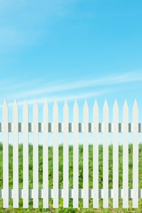 Slim post, spike-topped white fence.