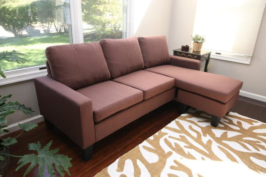 A lovely dusky brick-colored sectional sofa with easy to clean linen upholstery and an adjustable, reversible chaise. Another great option for a small space.
