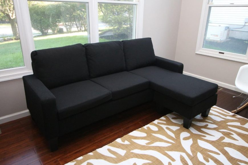Gentil A Rich Black Cloth Sectional With A Sleek Modern Silhouette. Perfect For A  Modestly Sized