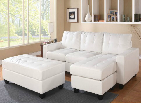 This snug set consists of a reversible chaise sectional and two matching ottomans, one small and one large.