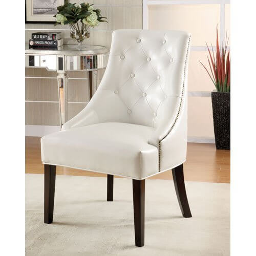 White faux leather lounge chair from Coaster Home Furnishings features tufted leather back with nailhead trim on sloped arms over cappuccino finished wooden legs.