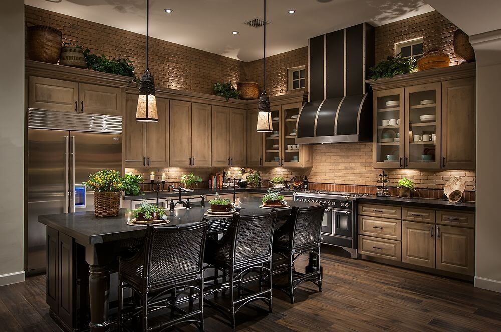 Gentil Brown Tile Walls Match Wood Cabinetry And Darker Hardwood Flooring In This  Kitchen Centered Around Black