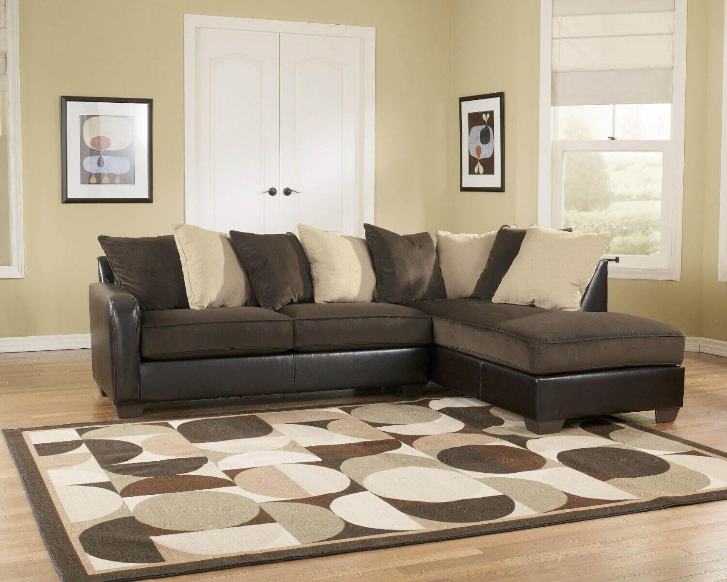 This piece from Ashley Furniture is a contemporary design that utilizes two popular design colors: beige and espresso.