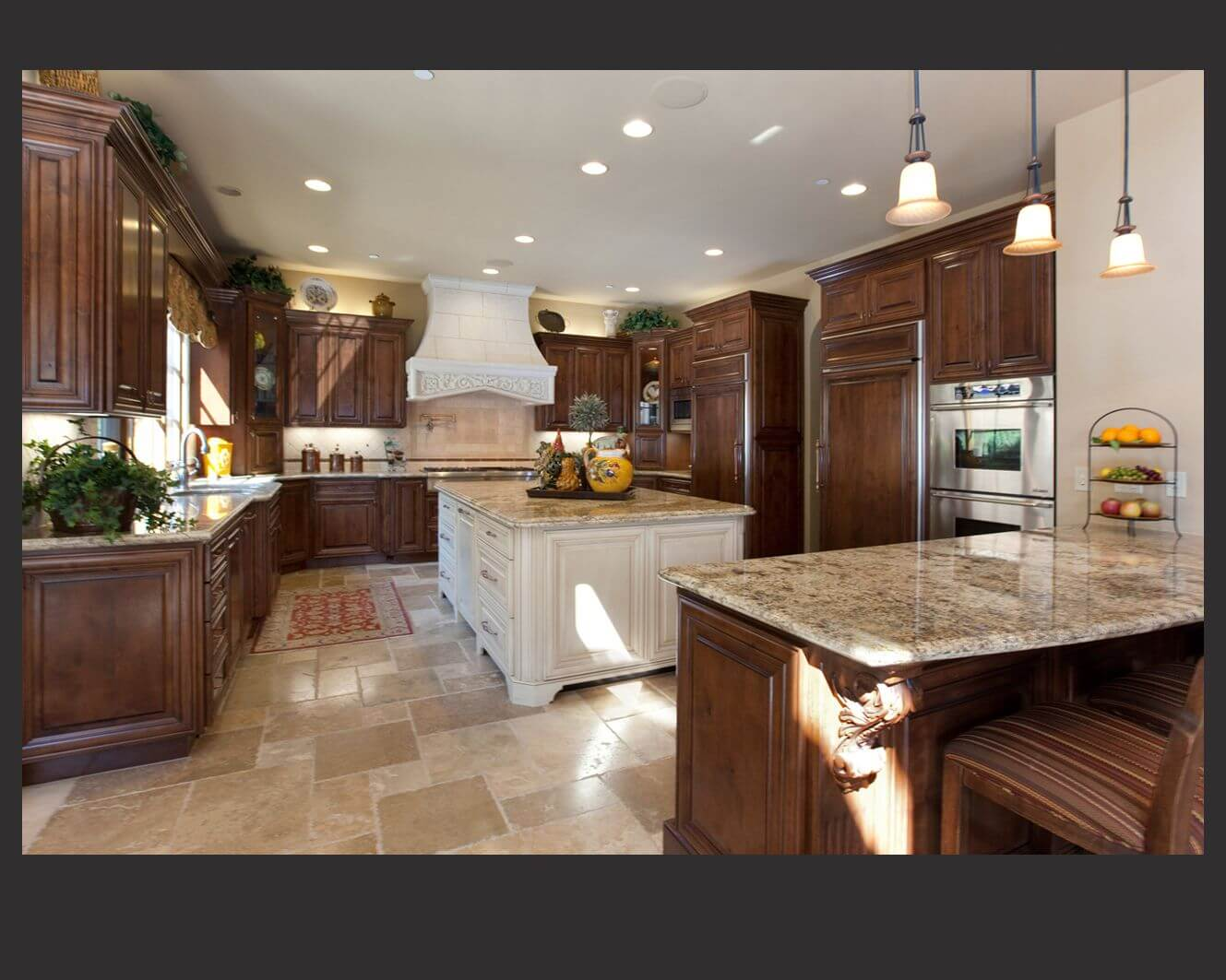 Gentil Richly Detailed U Shaped Kitchen Centers Dark Wood Cabinetry Around Large,  White Painted Wood