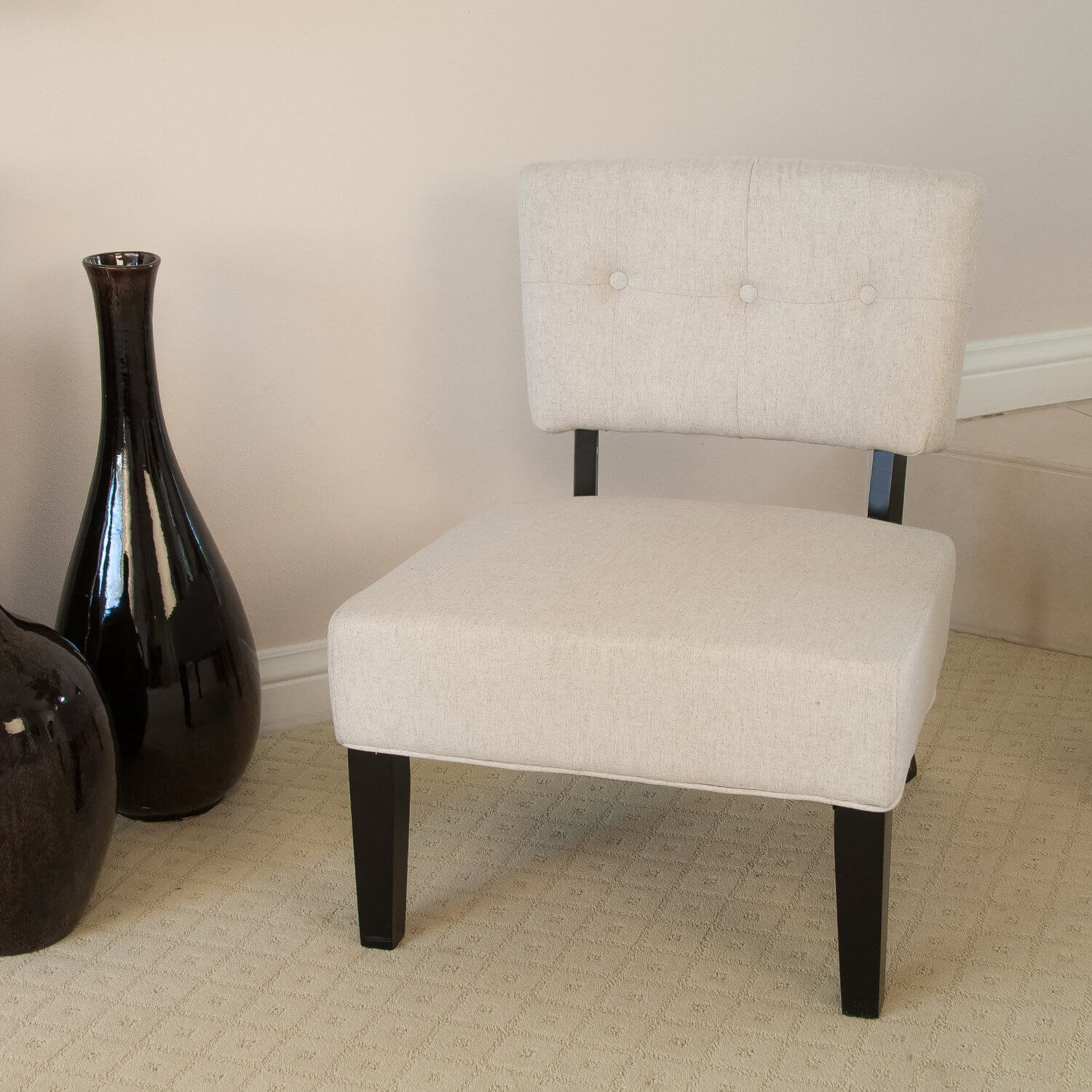 This is a simple, yet elegant accent chair that lightens up a darker room motif (thanks to the chocolate wooden legs) or fits in with lighter furniture