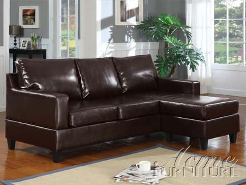 This reversible sectional is espresso-colored bonded leather and consists of loveseat and a chaise.