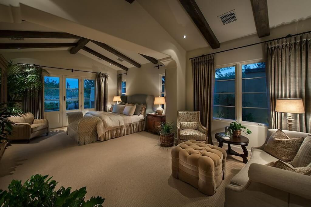 With a slight exposed wood-beamed cathedral ceiling, this large master bedroom suite is a true retreat from the rest of the home