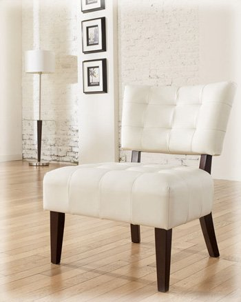 This Signature Design By Ashley accent chair mounts tufted seat and back over dark tapered showood legs. The ivory faux leather cushions are durable and beautiful, contrasting perfectly with the frame and adding brightness to any living room.