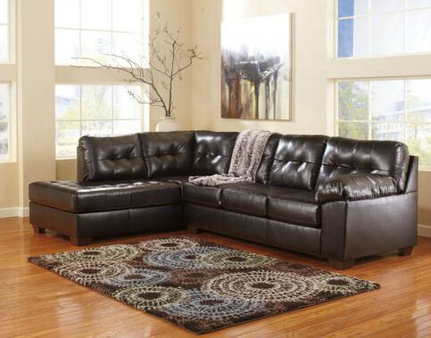 For those who desire a uniform color, this chocolate two-piece sectional can rule a living room.