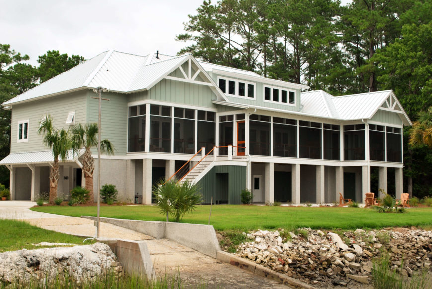 Large waterfront home (rear view) with screened in deck.