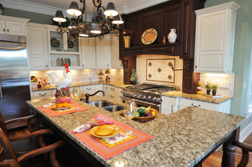 Compact, Richly Detailed Kitchen Holds This Two Tiered Island With Built In  Sink
