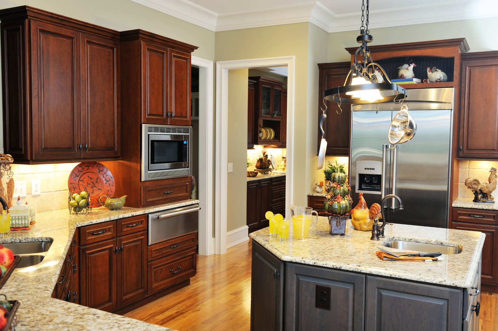 Cozy Kitchen Featuring Mixture Of Wood Tones, From Light Natural Flooring,  To Dark Cherry