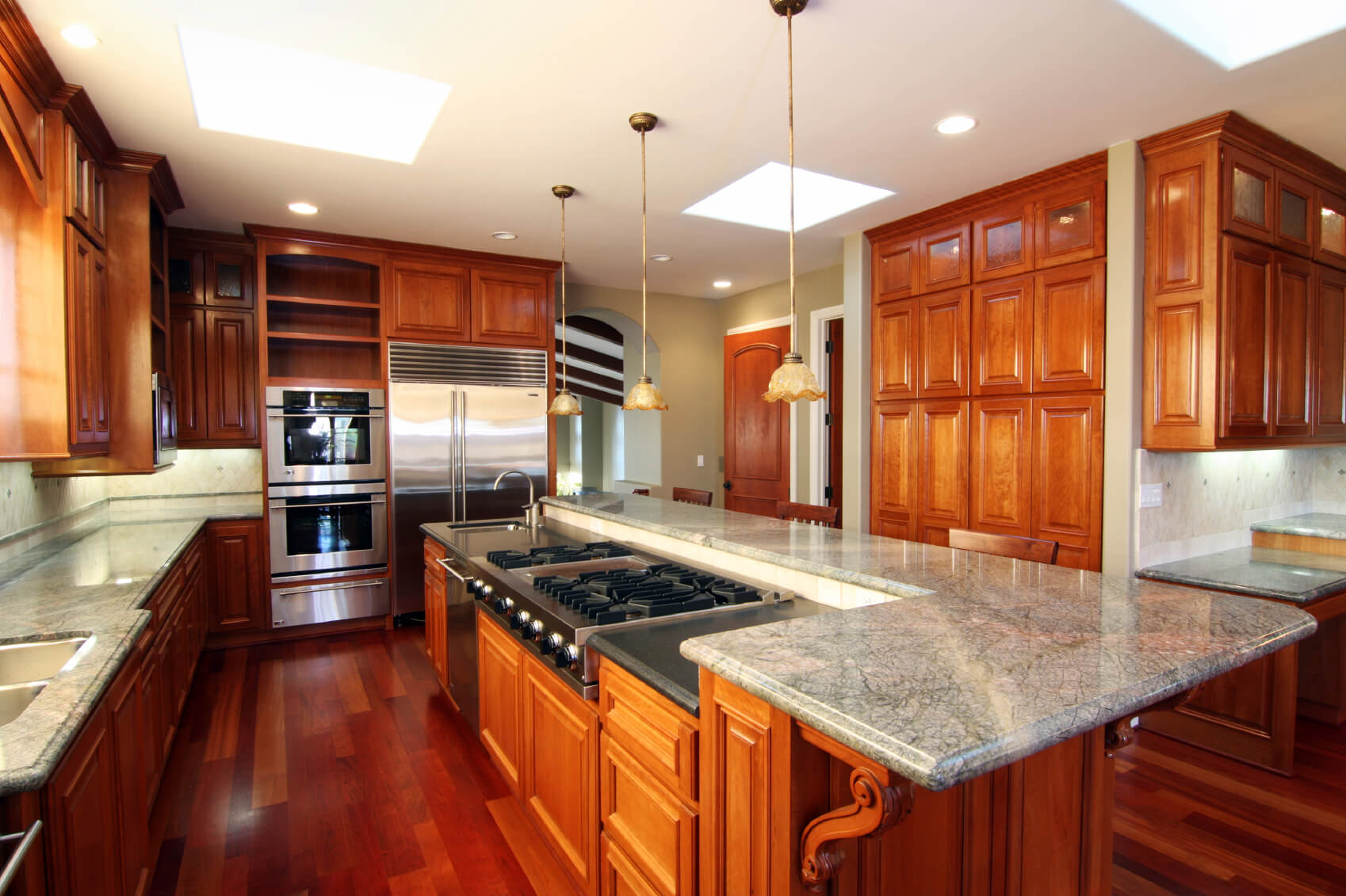 Kitchen Centered Around Lengthy Island Featuring Full Range, Sink, And  Dishwasher, Plus Raised