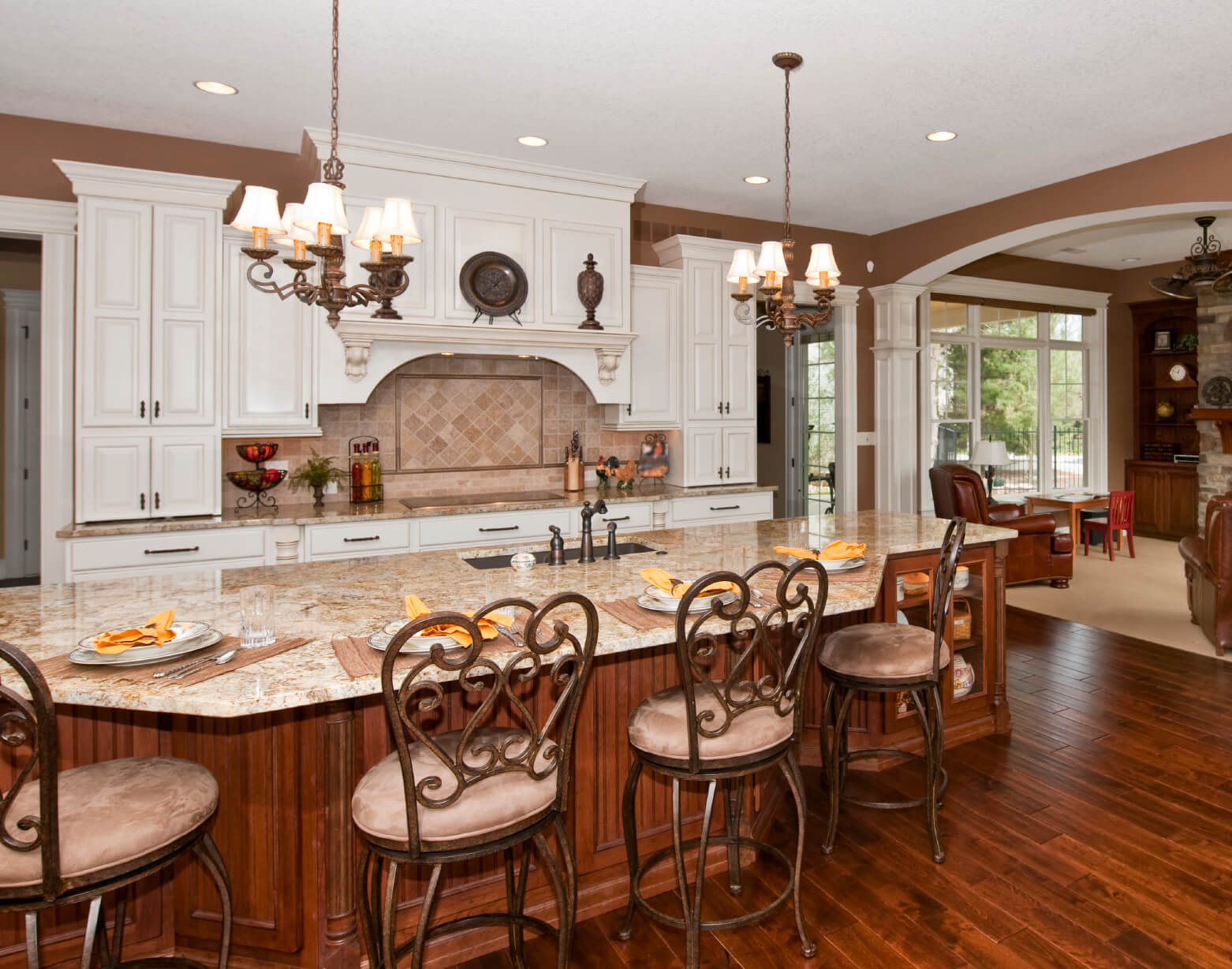 Large Open Kitchen Features Immense Island Done In Natural Wood Tones With Built
