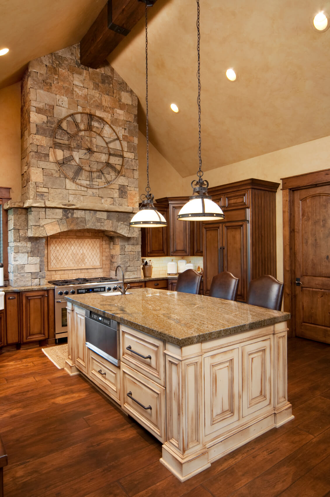 Rich Natural Wood Kitchen Holds This Large Contrasting Light Island At Center