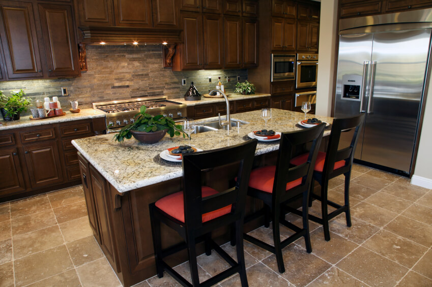 Ordinaire Large Marble Topped Island With Dining Space Centers This Kitchen Over  Beige Tile Flooring, With