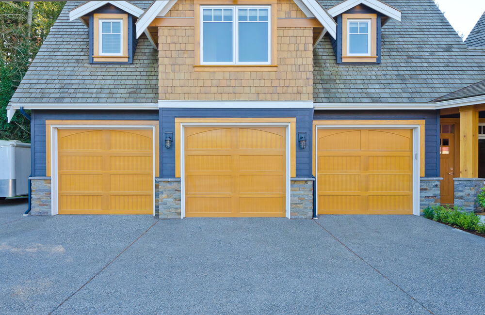 Here's a close-up view of the same garage. Notice the gold painted wood sandwiching subtle white frames, and the lower wall stone facade.
