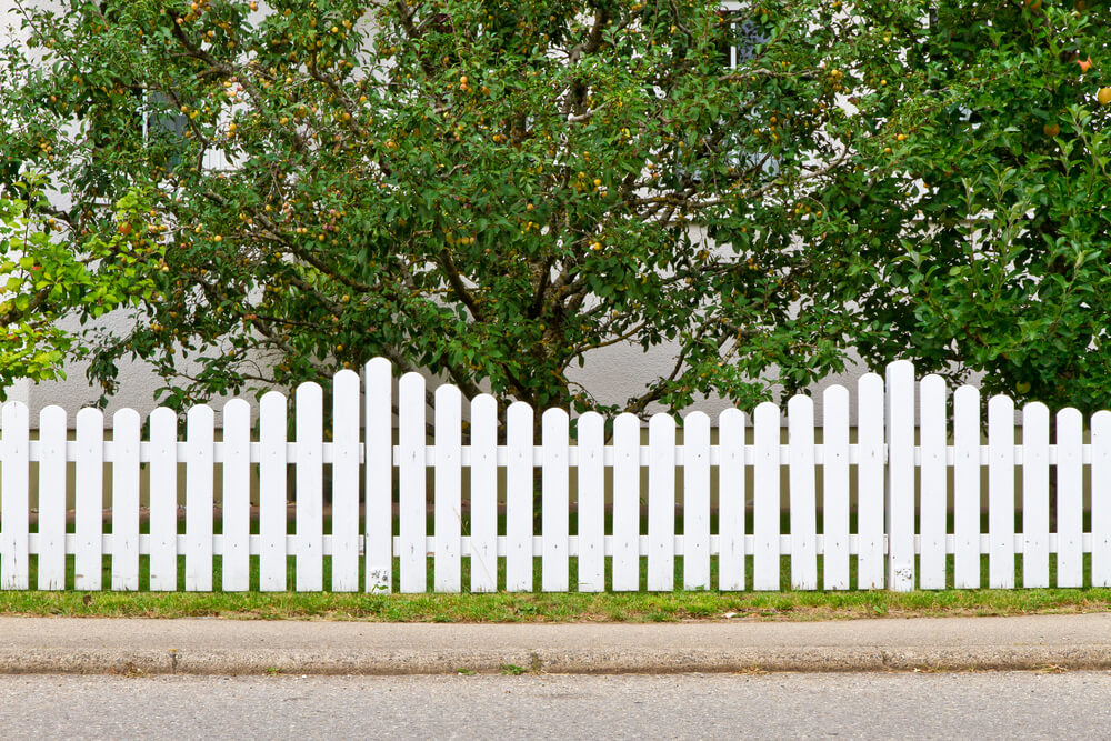 Here's another curved top, wave-like white picket fence, with rounded post tops.